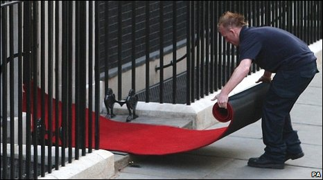 Man laying red carpet at Number 10