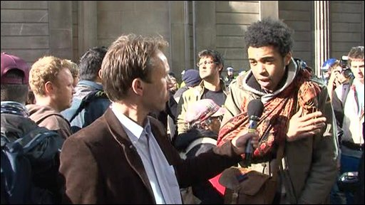 The BBC's Ben Brown talks to a protester outside the Bank of England