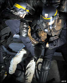 French riot police arrest a man after a demonstration (19 March 2009)