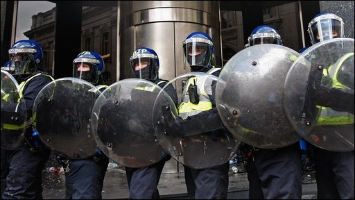 Police in Riot gear block access to a branch of RBS as they stop anti capitalist and climate change activists demonstrating in the City of London on April 1, 2009 in London