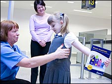 A child going through security checks at Manchester airport