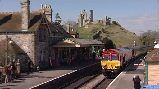 The train passing through Corfe Castle on the way to Swanage