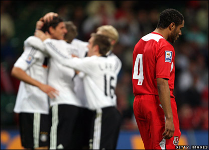 Germany celebrate; Ashley Williams, Wales