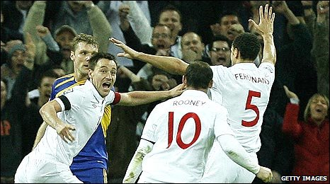 John Terry (left) wheels away in delight after scoring the winner against Ukraine