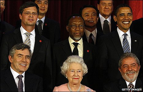 Gordon Brown sits next to the Queen in a photo of world leaders after a reception at Buckingham Palace