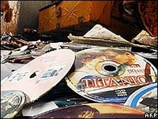 Fake DVDs being crushed