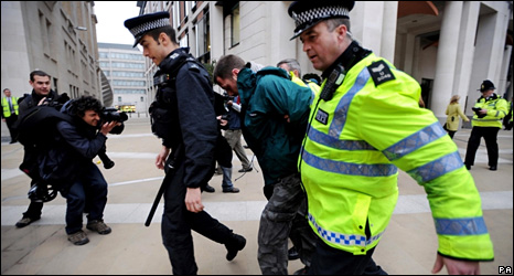 A man is led away by Police in Paternoster Square (2 April 2009)