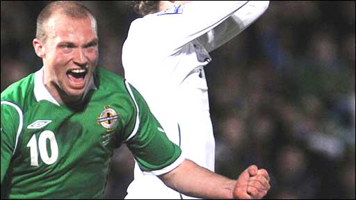 Warren Feeney celebrates his goal against Slovenia