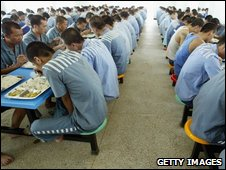Inmates have lunch at a mess hall at Haikou Prison, 2005