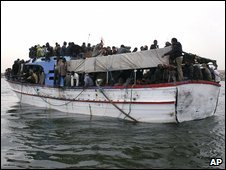 Migrants on an overcrowded boat arrive in Tripoli, 29 March 2009