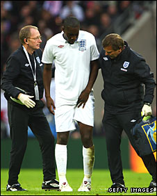 Carlton Cole limps off for England