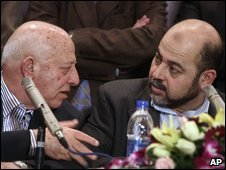 Top Palestinian officials Ahmed Qureia of Fatah, left, and and Moussa Abu Marzouk of Hamas seen during a news conference following talks in Cairo, Egypt, on 26 February 2009
