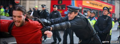 Policeman grabs a man in Threadneedle St in London on 2 April 2009