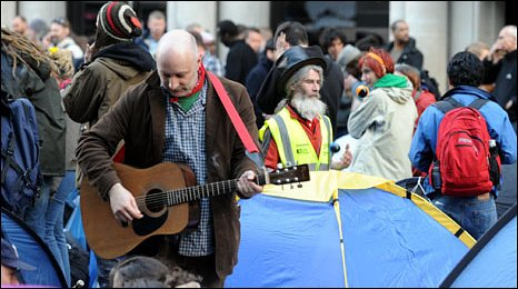 The Climate Camp in the City with a guitarist and juggler