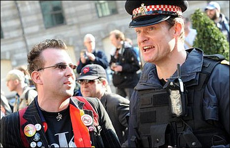 A police officer and a protester having a chat