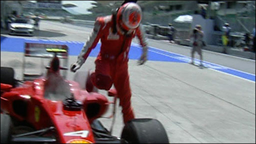 Kimi Raikkonen leaps out of his Ferrari
