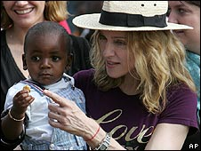 Madonna with adopted son David Banda