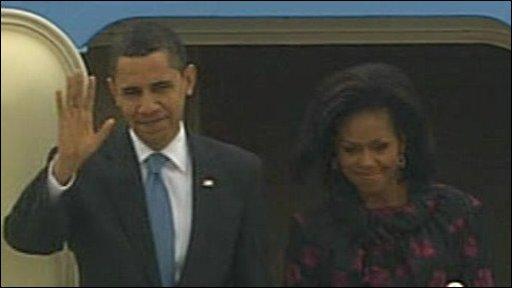 Obamas arrive in Germany