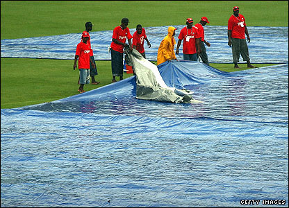 Groundstaff move the covers in St Lucia