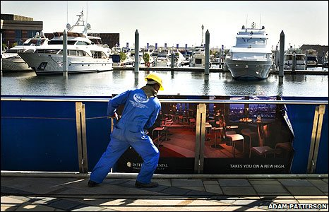 Worker in front luxury yachts