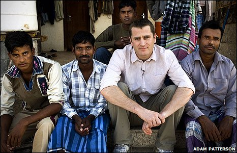 Ben Anderson sitting with Dubai workers