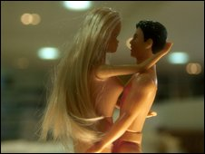 Ken and Barbie pretend to make love