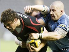 Cardiff prop John Japp (right) gets to grips with Ross Ford