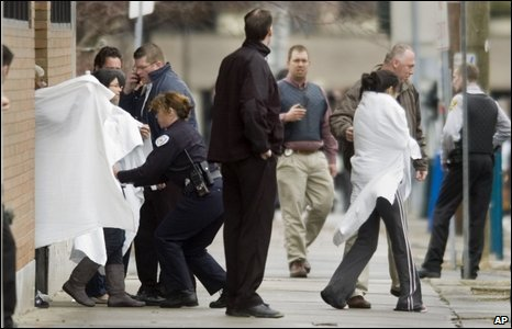 Hostages exit a building near the American Civic Association in downtown Binghamton, NY