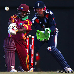 Shivnarine Chanderpaul tries to slog-sweep a ball from Paul Collingwood but holes out in the deep