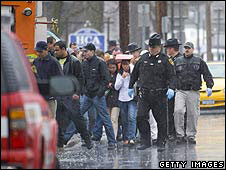 Police lead hostages to safety in Binghamton, New York, 3 April 2009