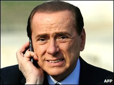 Silvio Berlusconi speaks on his mobile phone during the French-German Nato summit, 4 April 2009