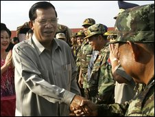 Cambodian Prime Minister Hun Sen, left, shakes hands with his soldiers in Kampot province, Cambodia, 4 April 2009