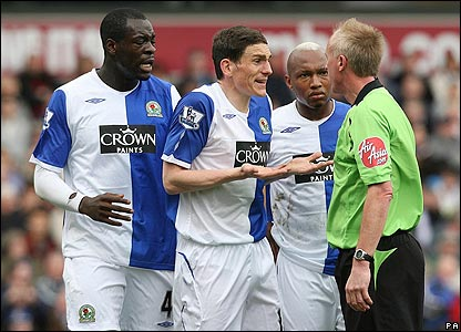 Blackburn's players are furious with referee Peter Walton