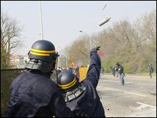 French riot police throw stun grenades at rioters in Strasbourg, 4 April