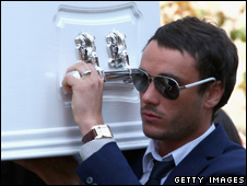 Jack Tweed carries Goody's coffin
