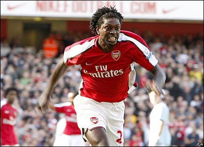 Emmanuel Adebayor celebrates scoring for Arsenal