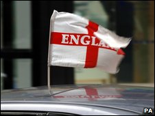 A motorist flies the English flag