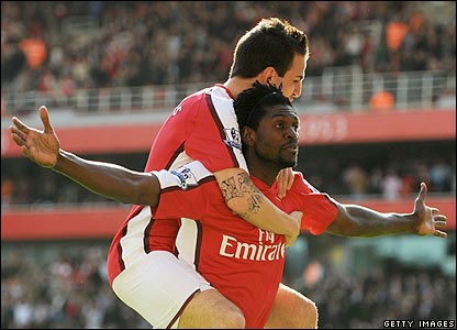 Adebayor celebrates scoring his second