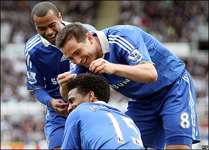 Florent Malouda is congratulated by his Chelsea team-mates