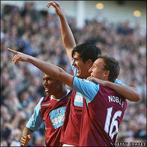 James Tomkins celebrates scoring West Ham's second