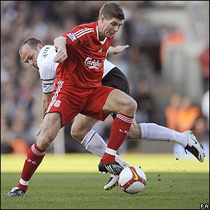 Reds captain Steven Gerrard battles for possession with Danny Murphy