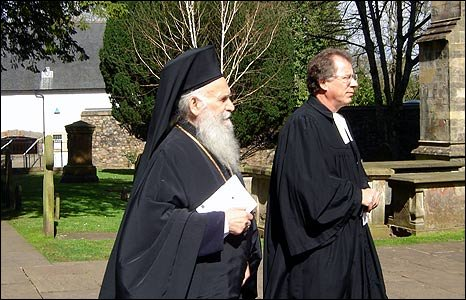 Image shows two members of the clergy walking in the parade
