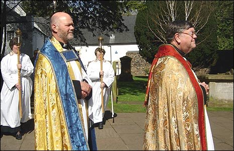 Image shows more members of the clergy making their way into Llandaff Cathedral