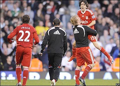 Liverpool's Yossi Benayoun is congratulated after scoring the winner