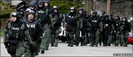 Police officers gather at the crime scene in Pittsburgh, Pennsylvania 04/04