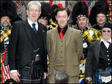 Culture Minister Mike Russell (left) and Alan Cumming at the parade - copyright Debra L Rothenberg/PA Wire (Feature Photo Service)