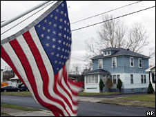 A flag flies outside a property opposite Wong's family home