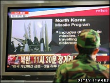 A South Korean soldier watches news of the launch in Seoul on 5 April 2009