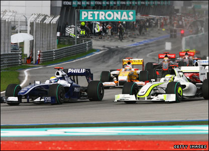 Nico Rosberg squeezes past Jenson Button