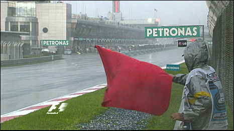 The red flag comes out as the rain comes down in torrents at the Sepang circuit
